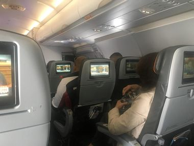 Passengers watch the Senate Judiciary Committee hearing on flight JetBlue 415 from New York to San Francisco, U.S. September 27, 2018 in this image obtained from social media. Zette Emmons/via REUTERS ATTENTION EDITORS - THIS PICTURE WAS PROVIDED BY A THIRD PARTY. NO RESALES. NO ARCHIVE. MANDATORY CREDIT.