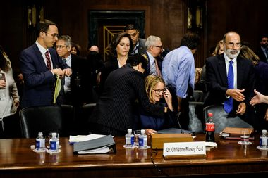 Christine Blasey Ford is hugged by her lawyer Debra S. Katz after the hearing of Senate Judiciary Committee for Christine Blasey Ford to testify about sexual assault allegations against Supreme Court nominee Judge Brett M. Kavanaugh on Capitol Hill in Washington DC, U.S., September 27, 2018. Gabriella Demczuk/Pool via REUTERS
