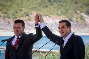 June 17, 2018 - Prespes, Greece - Greek Prime Minister Alexis Tsipras, right, and his Macedonian counterpart Zoran Zaev, left, during a signing of an agreement on Macedonia's new name in the village of Psarades, Prespes Greece. The preliminary deal launches a long process that will last several months. If successful, it will end a decades-long dispute between neighbors Greece and Macedonia which will be renamed North Macedonia., Image: 375216767, License: Rights-managed, Restrictions: , Model Release: no, Credit line: Profimedia, Zuma Press - News