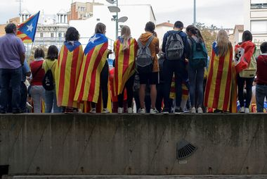 People wear Catalan separatist flags during ceremonies marking the first anniversary of Catalonia's banned independence referendum in Girona, Spain, October 1, 2018. REUTERS/Jon Nazca