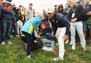 PARIS, FRANCE - SEPTEMBER 28: Brooks Koepka of the United States signs a glove and gives it to a lady who was hit by the ball on the sixth during the morning fourball matches of the 2018 Ryder Cup at Le Golf National on September 28, 2018 in Paris, France. (Photo by Jamie Squire/Getty Images)