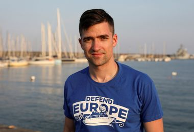 Martin Sellner, spokesman for Identitarian movement in Austria, poses in the harbour of Catania, Italy, July 19, 2017. Picture taken July 19, 2017. REUTERS/Antonio Parrinello - RC171E23A230