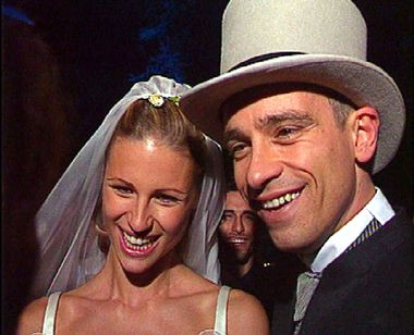 Italian pop singer Eros Ramazzotti smiles with his bride Swiss model Michelle Hunzicker following their wedding April 24. Ramazzotti and Hunziker were married on the outskirts of Rome in a star-studded ceremony with over 400 guests in Bracciano Castle outside Rome. REUTERS - RP1DRIEXIUAA