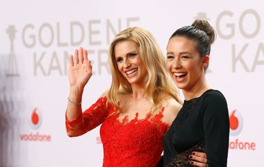 TV presenter Michelle Hunziker and her daughter Aurora (R) arrive on the red carpet for the 'Die Goldene Kamera' (Golden Camera) awards ceremony in Hamburg, February 6, 2016. The Golden Cameras are awarded by a popular German TV magazine honouring excellence in the areas of television, film and entertainment. REUTERS/Morris Mac Matzen - LR1EC261QX0EZ