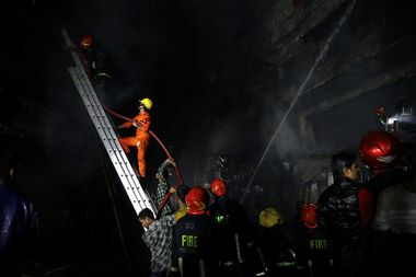 Firefighters work at the scene of a fire that broke out at a chemical warehouse in Dhaka, Bangladesh February 21, 2019. REUTERS/Mohammad Ponir Hossain