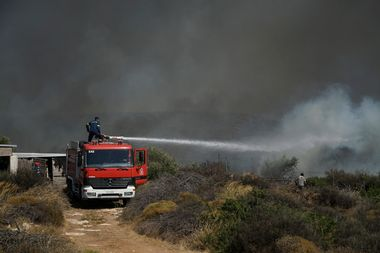 Firemen douse a fire on the island of Elafonissos, on the southern edge of Peloponnese Peninsula on August 10, 2019, forcing a precautional evacuation of a popular camping site. The fire was brought under control and no injuries were reported. Greece on August 10, 2019, battled over 50 wildfires nationwide, including a major blaze near Athens, in a dangerous mix of high temperatures and strong winds unseen in nearly a decade. The fire department said it had mobilised more than 450 firemen and 23 aircraft nationwide to tackle the fires, including one on the island of Elafonissos and two around Marathon, near Athens., Image: 464149785, License: Rights-managed, Restrictions: , Model Release: no, Credit line: Profimedia, AFP