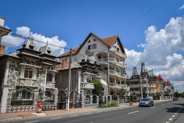 Palaces belonging to Romanian Roma people are pictured in Buzescu village, southern Romania, on July 11, 2019. In Romania's fields or on the outskirts of villages, the