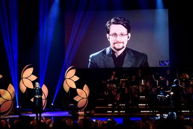 Former Right Livelihood laureate Edward Snowden speaks from a video screen during the 2019 Right Livelihood Award ceremony at Cirkus, Stockholm, Sweden December 4, 2019. TT News Agency/Erik Simander via REUTERS ATTENTION EDITORS - THIS IMAGE WAS PROVIDED BY A THIRD PARTY. SWEDEN OUT. NO COMMERCIAL OR EDITORIAL SALES IN SWEDEN.