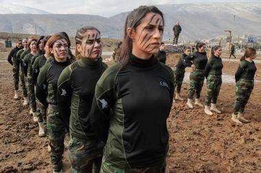 Iraqi Kurdish Peshmerga female officers take part in a graduation ceremony in the Kurdish town of Soran, 100 kilometres northeast of Arbil, the capital of Iraq's autonomous Kurdish region, on February 12, 2020. (Photo by SAFIN HAMED / AFP)