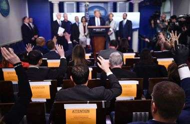 Reporters ask questions as US President Donald Trump speaks during a press briefing at the White House in Washington, DC, on March 16, 2020. - The first human trial to evaluate a candidate vaccine against the new coronavirus has begun in Seattle, US health officials said, raising hopes in the global fight against the disease. (Photo by Brendan Smialowski / AFP)